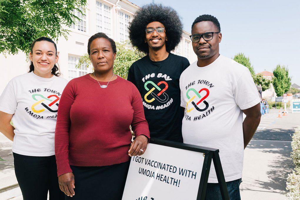 Photo of Kim Rhoads with staff members of Umoja Health Partners at a vaccine clinic.