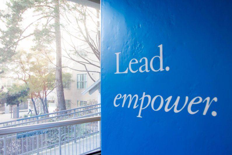 "pillar showing words ""Lead. Empower."""
