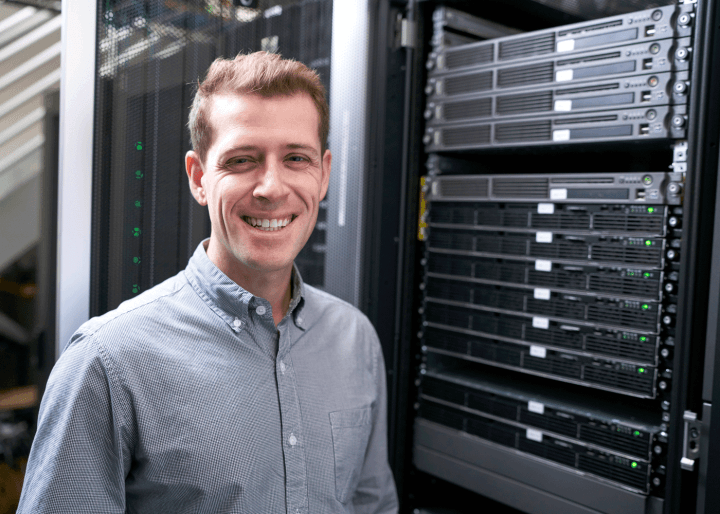michael keiser standing next to a server.