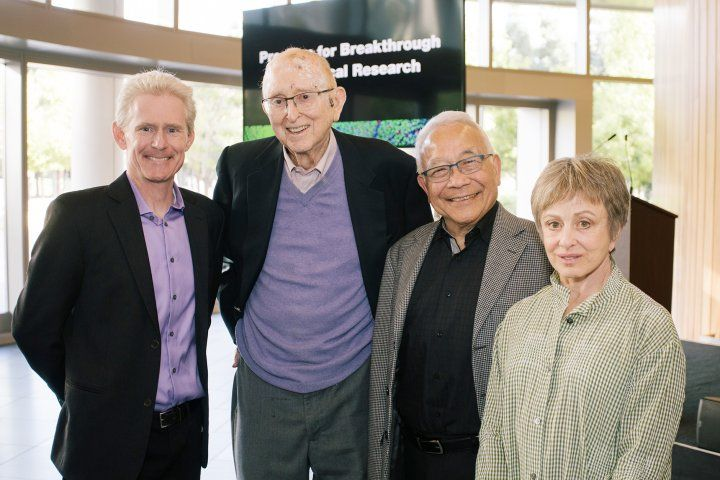 Herb Sandlers poses with others