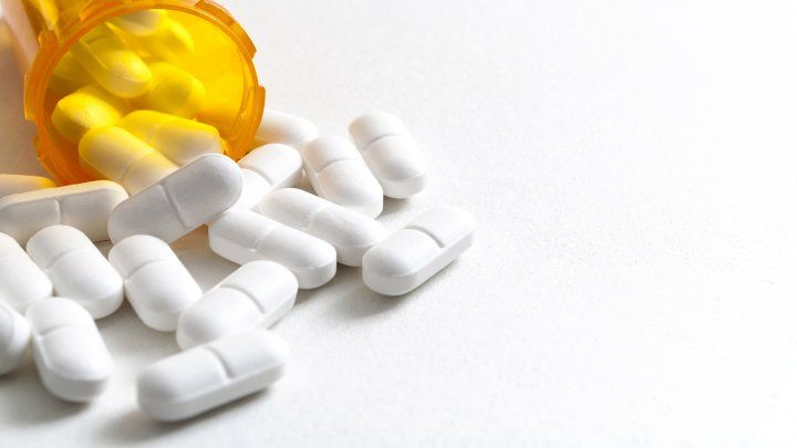 pills pour out of a bottle