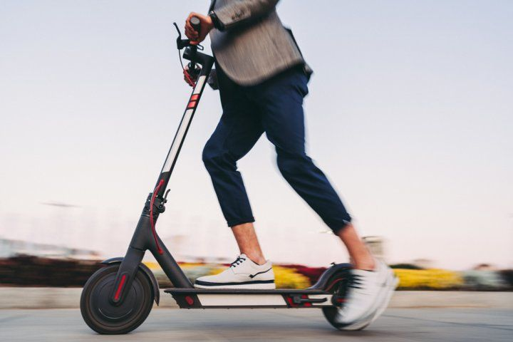man riding an e-scooter