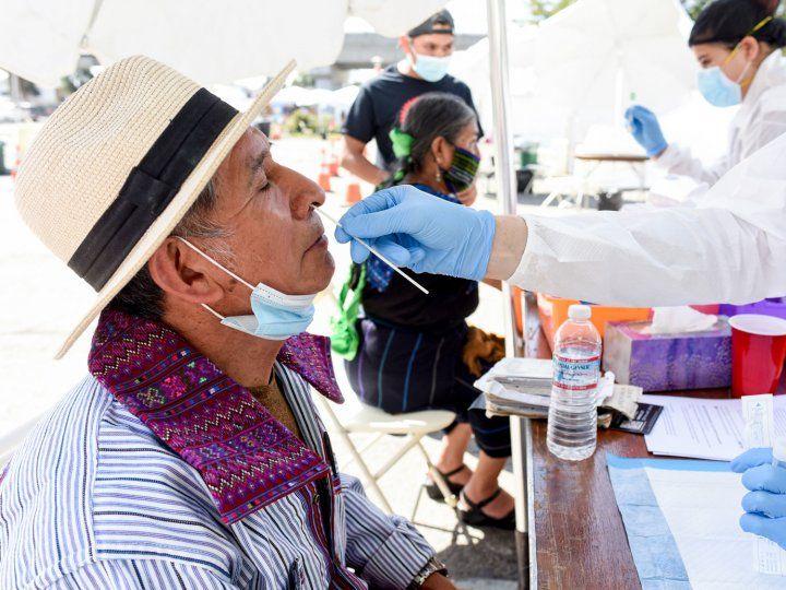 Man wearing hat gets a nose swab