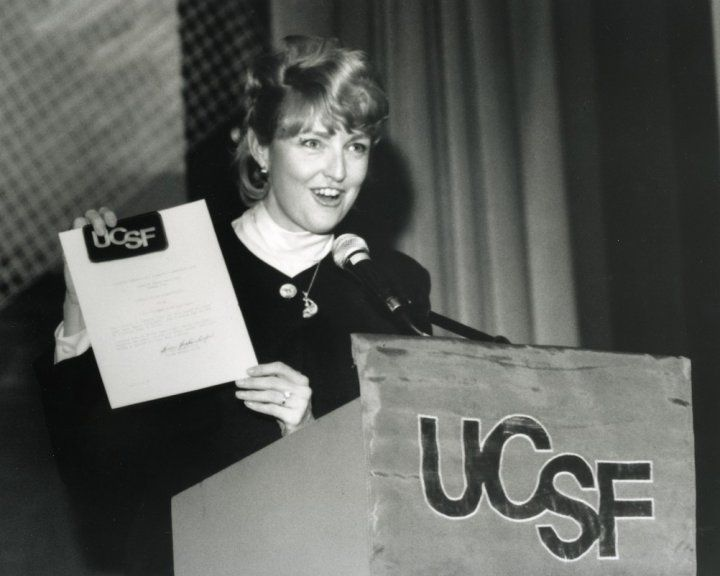Millie Hughes-Fulford speaking at a podium in 1992