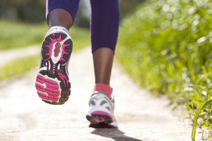 closeup of woman's shoes while she is running