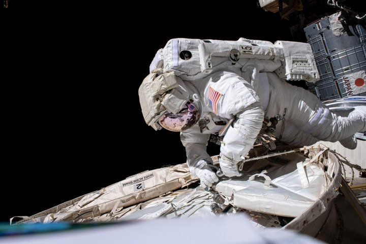 an astronaut on a spacewalk outside of a space station  - NASA astronaut spacewalk - Space Travel Weakens Our Immune Systems – Now Scientists May Know Why