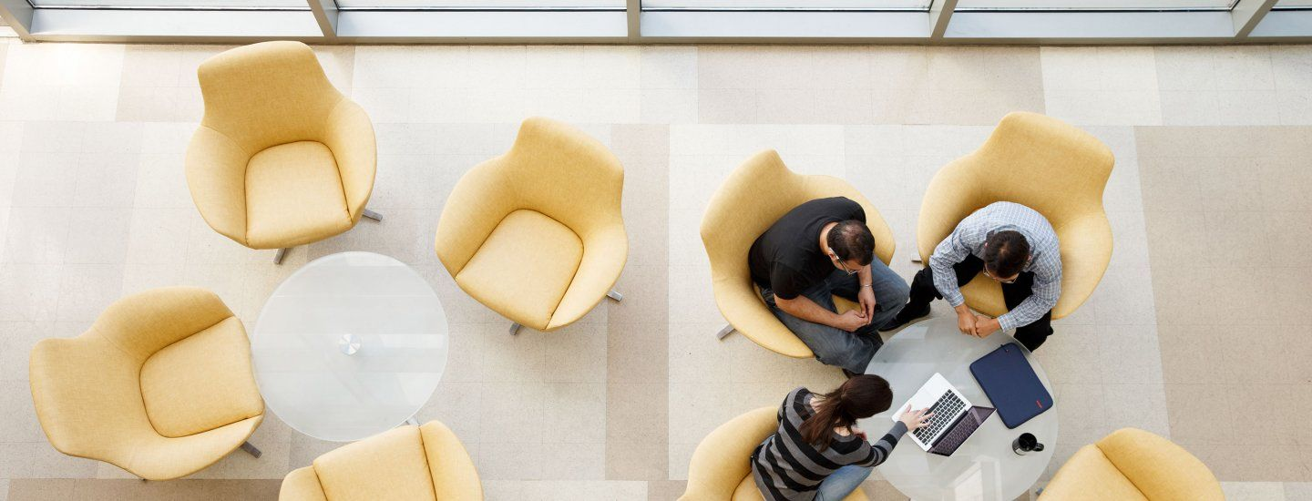 3 people working together in a lounge area