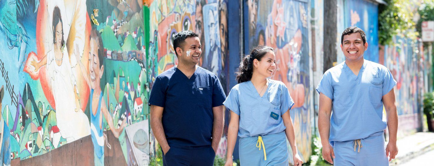 3 UCSF students walking in the Mission