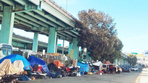 homeless encampment lining a San Francisco street