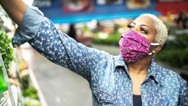 Woman wearing a cloth face mask in a grocery store