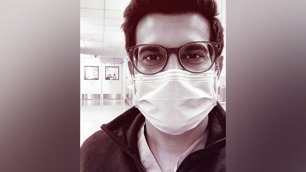Portrait of Sajan Patel wearing a face mask in the hospital.
