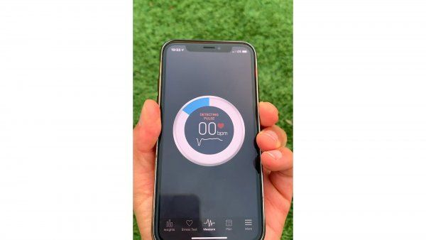 holding smartphone with diabetes detection app