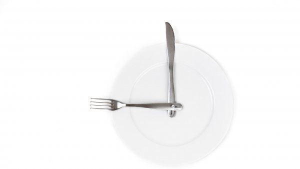 plate with fork and knife to make look like a clock