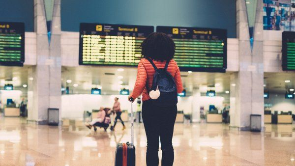 woman standing in an airport terminal