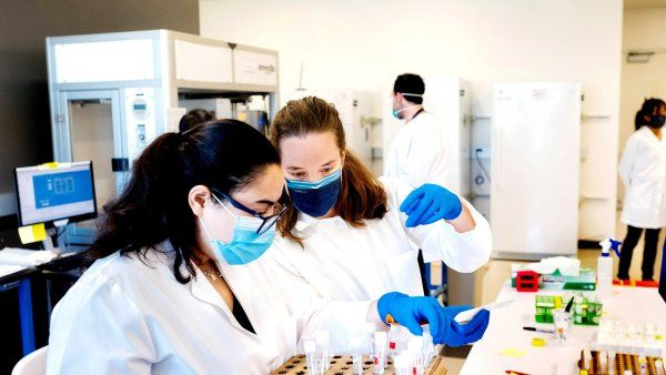 two female researchers work in a lab