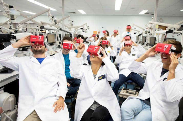 dentistry students looking at virtual reality headsets