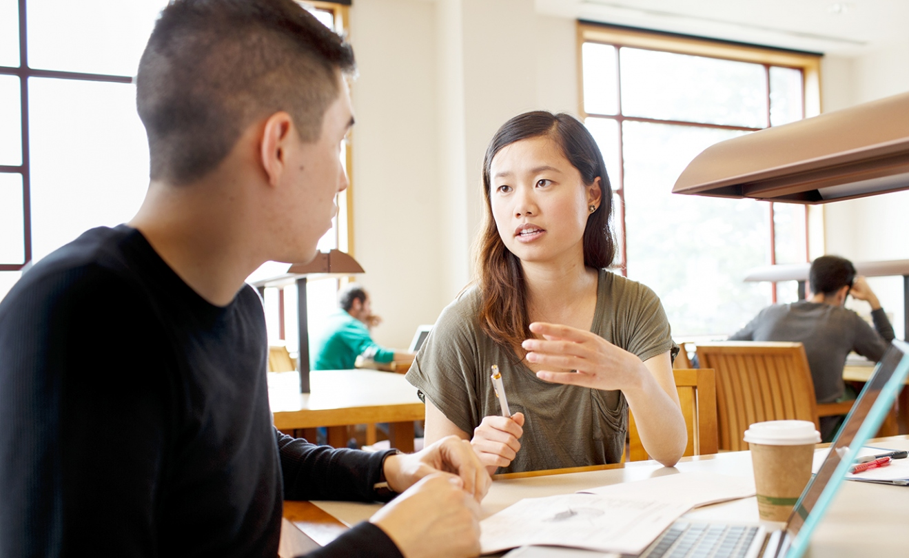 UCSF School of Medicine students Mengya Wu and Manuel Gonzalez talk in the UCSF library