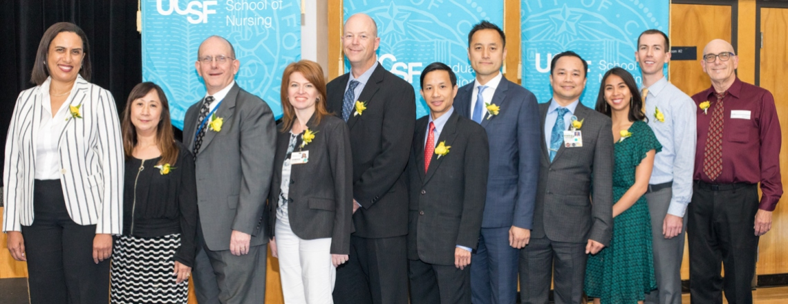 2017 Founders Day awardees Kirsten Bibbins-Domingo, Jane Wong, Michael Nordberg, Alexsandrina Eppel, Travis Clark, Khang Nguyen, Wayne Cheung, Jeselle Abilla, Heyman Oo, Peter Cooch, and Robert Pizzi pose for a photo after the awards ceremony