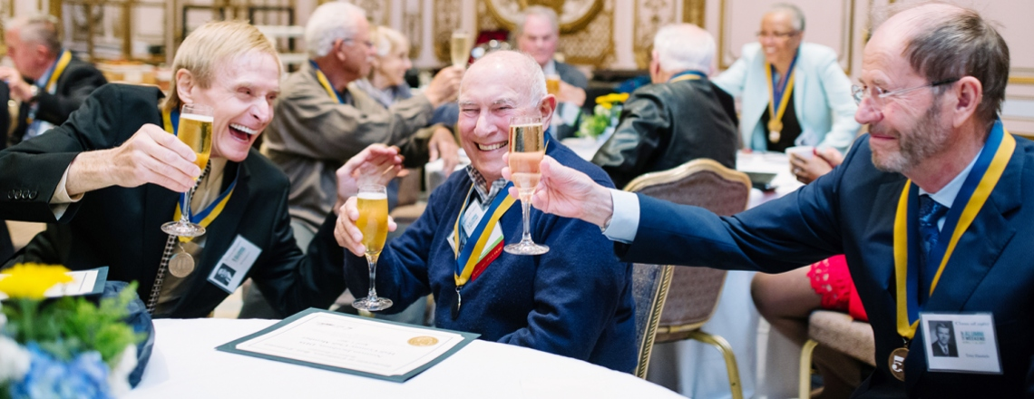 UCSF alumni cheers one another during a 50th anniversary gathering