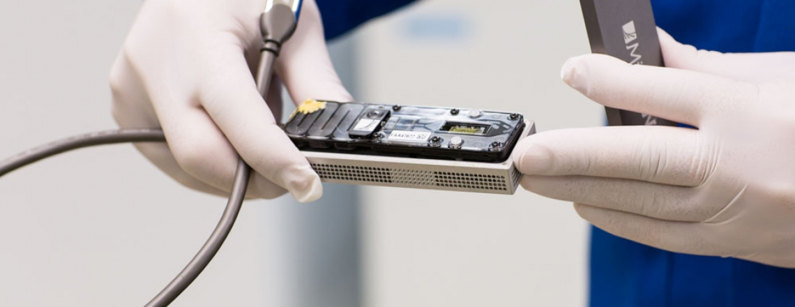 close-up view of a small genetic sequencing device