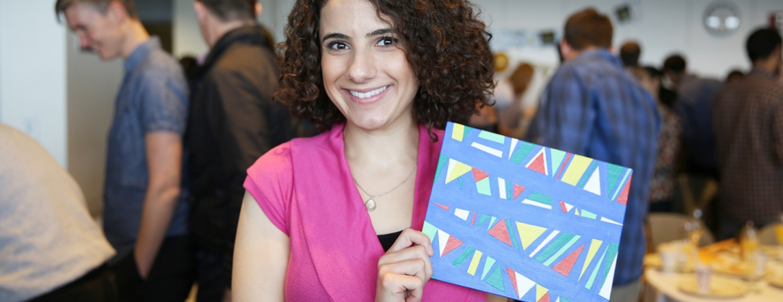Nancy Nasrawin holds her painting during Match Day