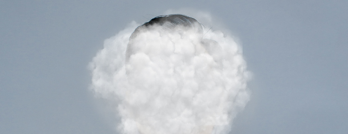 Face obscured by cloud of smoke