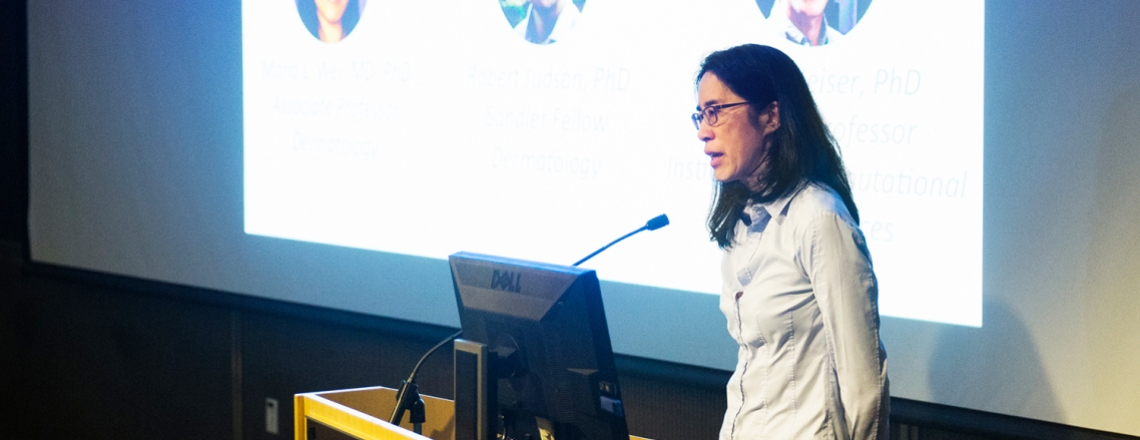 Maria Wei presents during the Cancer Center Impact Grant competition