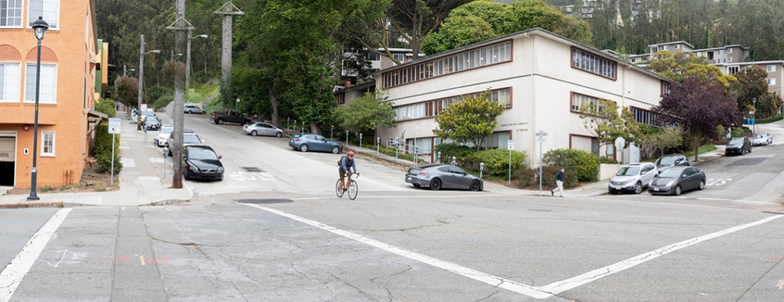 a bicyclist rides through the intersection at Fifth Avenue and Kirkham