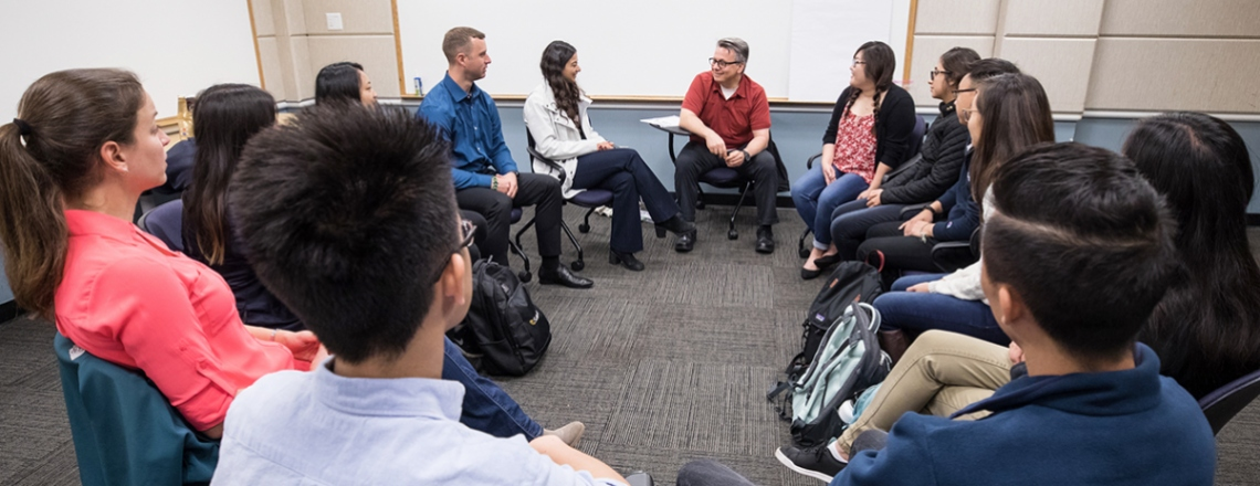 Igor Mitrovic addresses a group of students in a breakout group