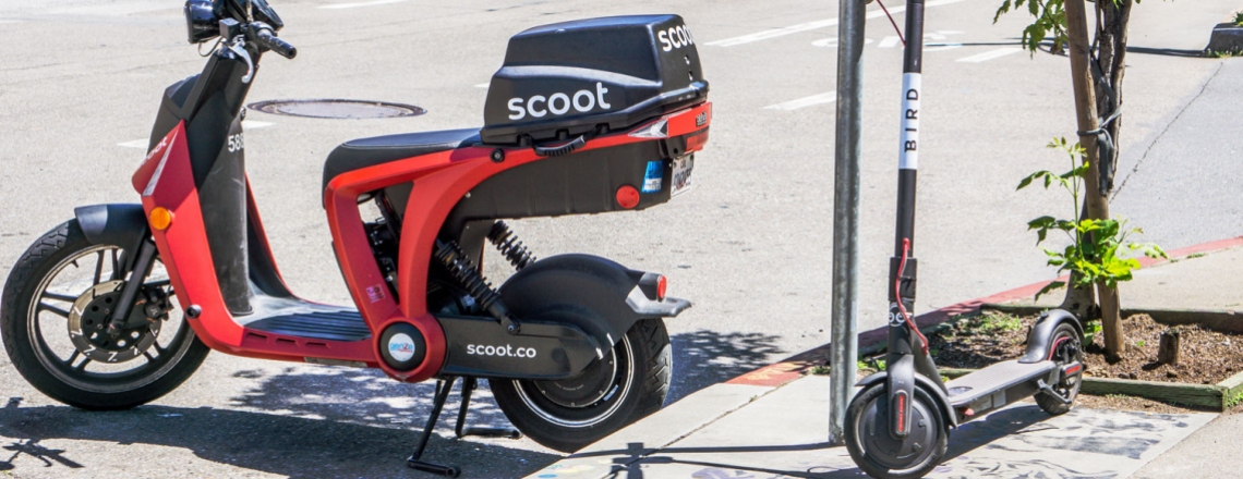 Motor scooter and kick scooter on the street