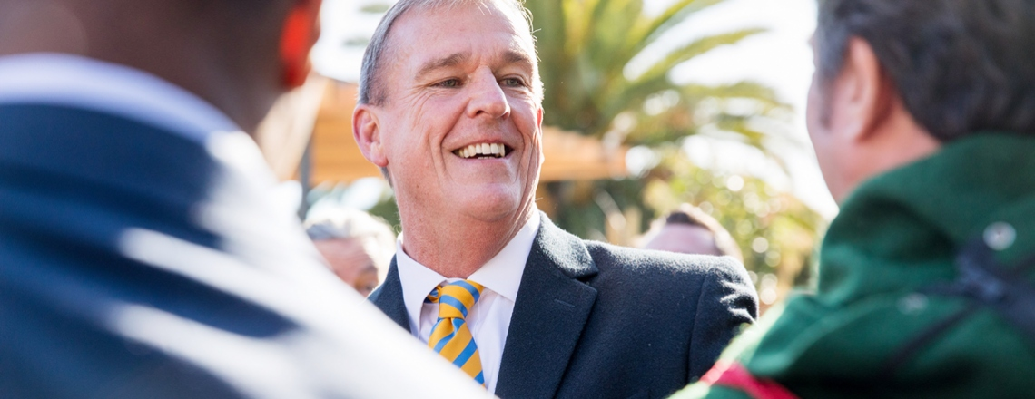 Jeff Sheehy talks to people at a press event announcing his appointment