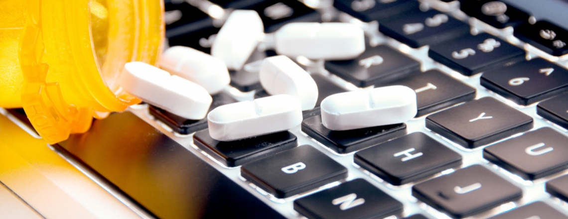 pills on a computer keyboard