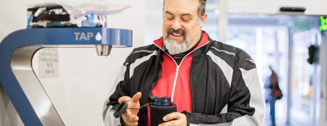 Dave Lieberman fills his water bottle at a water bottle filling station in Millberry Union at UCSF's Parnassus campus