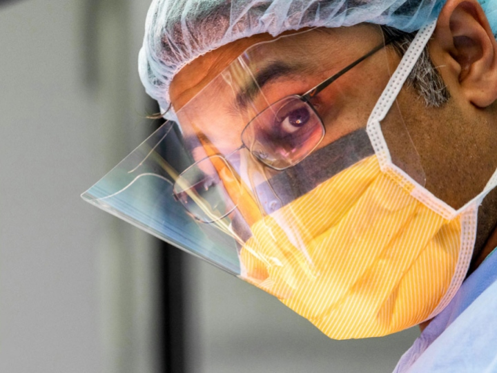close-up of surgeon with mask in his face