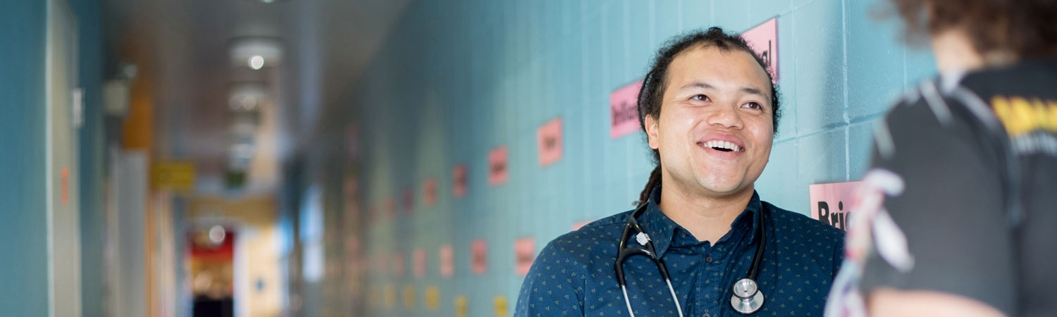 UCSF doctor talks to patient at New Generation Health Center