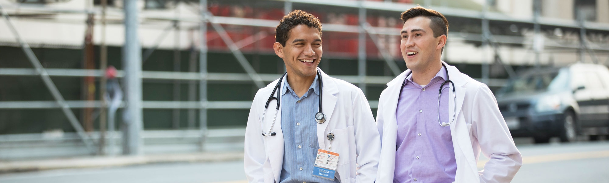 2 medical students walk down the street