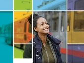 UCSF student standing in front of a Muni train