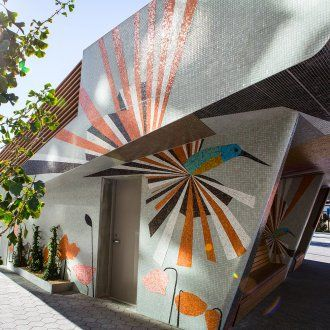 Bay Area-based artist Clare Rojas designed the public amphitheater in front of the UCSF Medical Center at Mission Bay with a mosaic of vivid, geometric shapes featuring hummingbirds