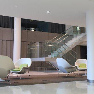 The interior of Mission Hall showing a large open lobby with minimalist chairs