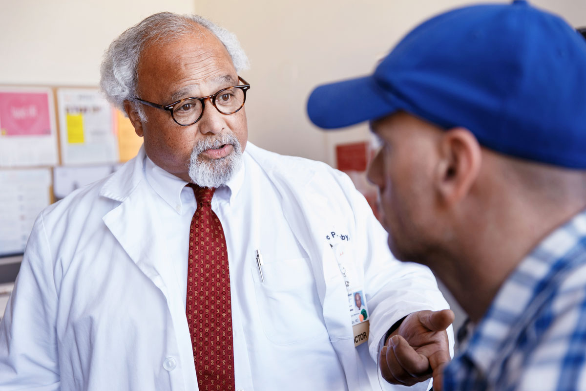 Eric Goosby speaks to a patient at Zuckerberg San Francisco General Hospital